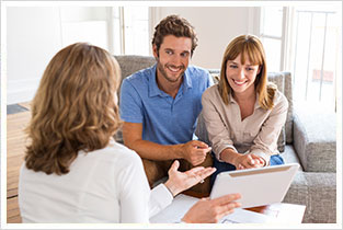Mortgage Broker Explaining a Couple Interested in Buying a House
