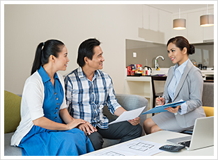 A couple discussing mortgage refinancing options with a broker